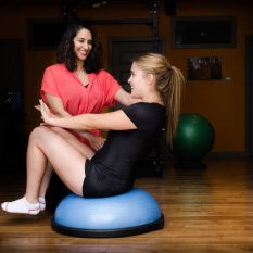 Mira teaching a patient physiotherapy exercises